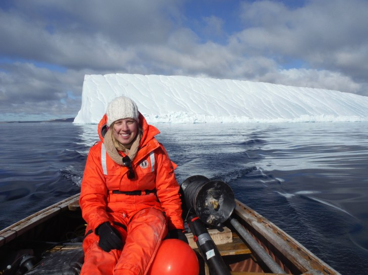 Melissa Nacke in front of the iceberg that she studied.
