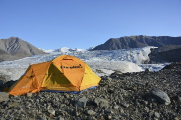 Adam's tent on the medial moraine of the Milne Glacier with the tributary glacier in the background.