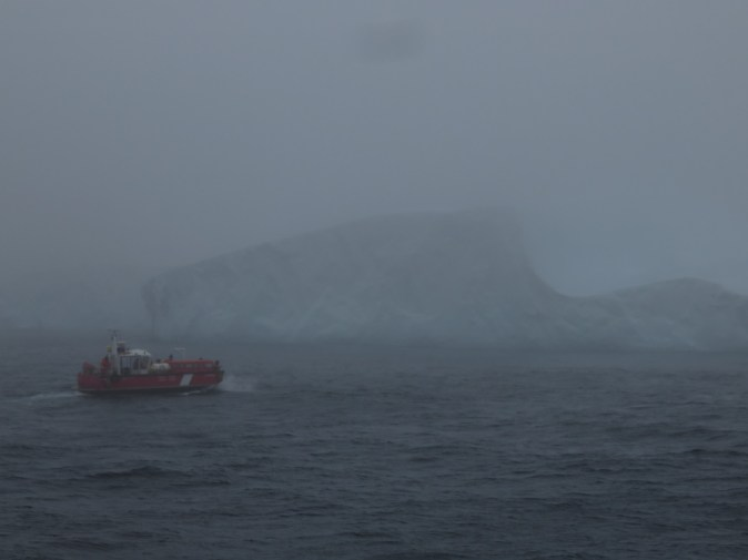The multi-beam surveys of the ice island keels were conducted from the CCGS Amundsen's barge. The survey target is in the background. Photo credit: Greg McCollough