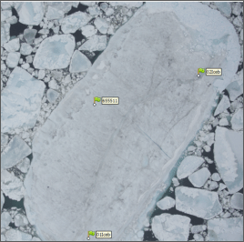 Example of an aerial photograph taken during SfM-photogrammetry surveying, and the GPS units marked.