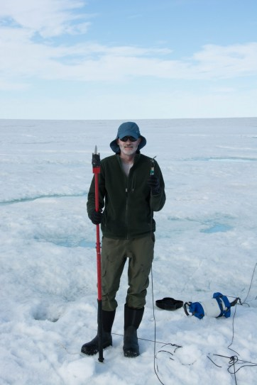 """Greg and the """"catch of the day"""" after fishing for sensors frozen into the ice shelf."""