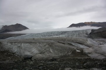 Low clouds rolling over a tributary glacier leading into the Milne Glacier.