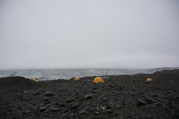 Milne Glacier camp as fog and inclement weather rolls in.