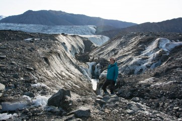 Jill standing amongst one of the many broken areas of the Milne Glacier.