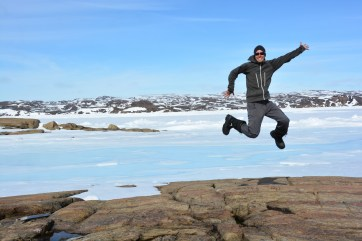 Adam Garbo jumping with joy at having good weather and no issues operating the UAV at the field site near Iqaluit! (M.St-Amant)