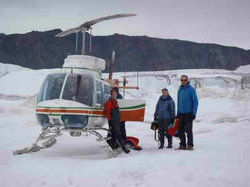 Jill Rajewicz, Kelly and Luke Copland being retrieved from a field site on the Milne Glacier.