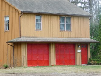 The Carriage House, a two car garage with a one bedroom apartment on top.