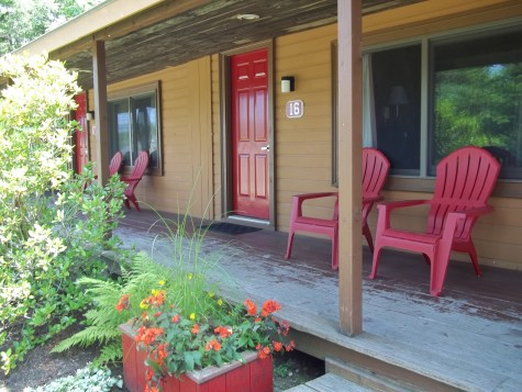 Photo of the cottage rooms with vertical slats covering the 2 feet of space between each cottage room.