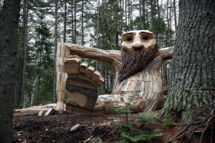 A giant wooden troll lurking in the woods at Coastal Maine Botanical Gardens