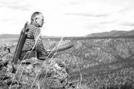 Aldo Leopold perched on a cliff. Photo courtesy of the Aldo Leopold Foundation.