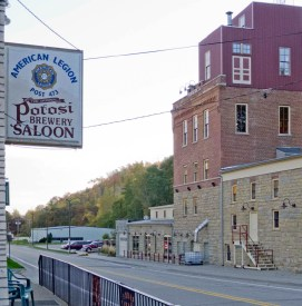 Potosi Saloon beer sign hangs across the street from the Potosi Brewery
