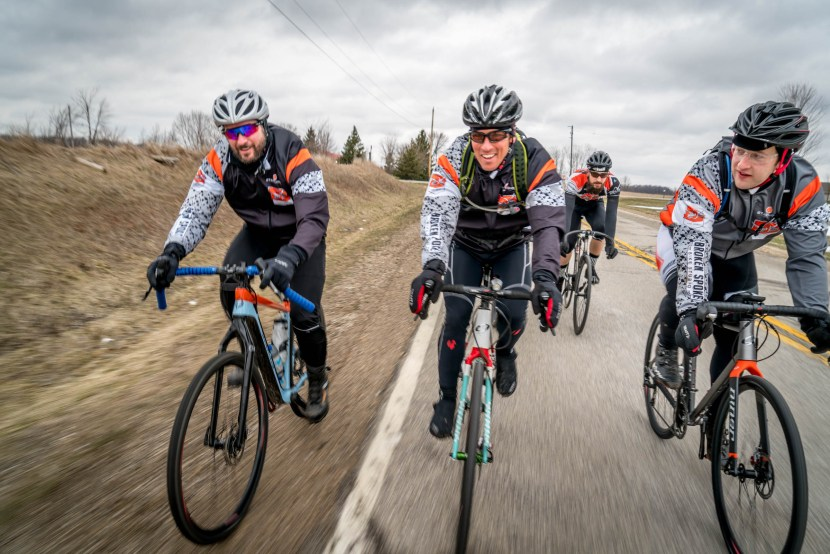 Four cyclists riding next to each other