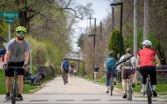 People walk and ride bicycles on the Southwest Path in Madison, WI