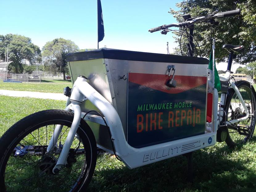 a cargo bike brings tools and supplies to the parks