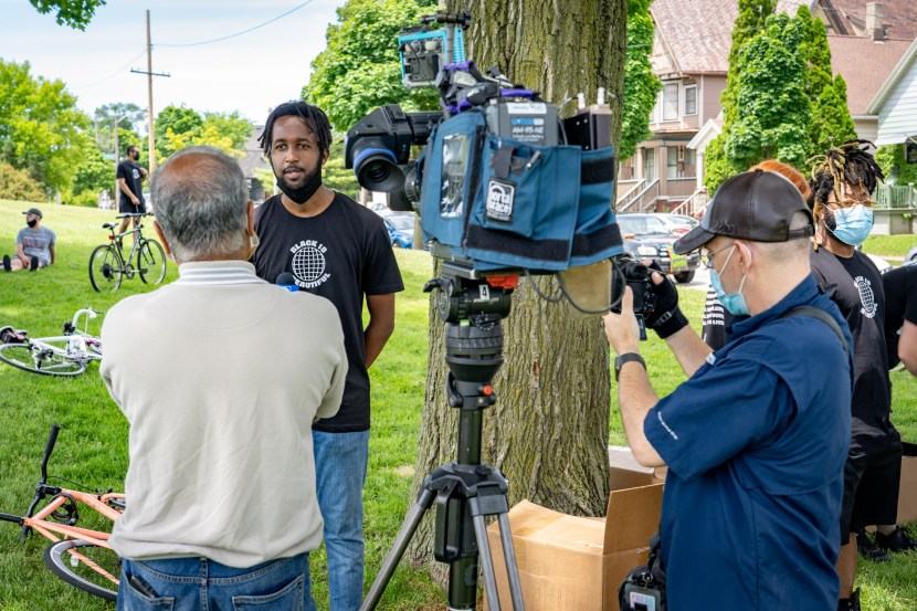 Sam (WebsterX) Ahmed is interviewed by news media before the Black is Beautiful Ride he helped organize