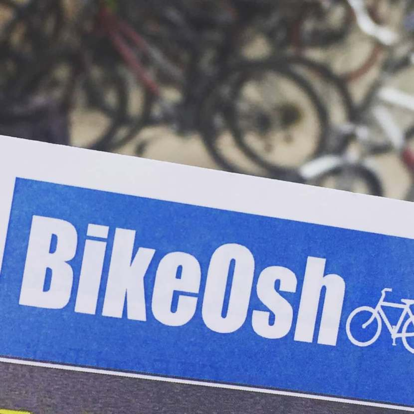 The blue BikeOsh logo.