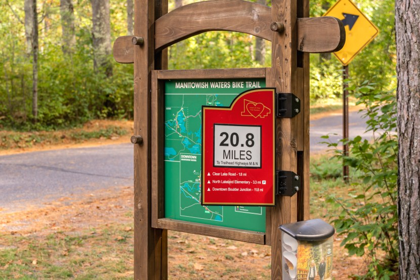 A sign on the Manitowish Waters Bike Trail indicate 20.8 miles distance from the nearest trailhead.