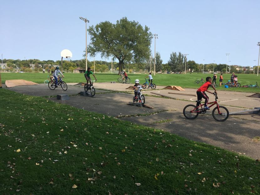 Young riders practice skills on jumps and ramps at Aldo Leopold Park.