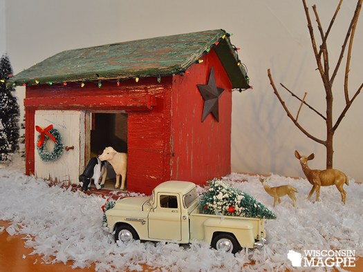 toy barn and truck in snow