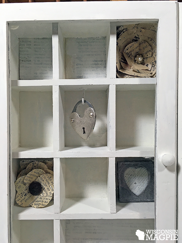 white farmhouse-style curio cabinet