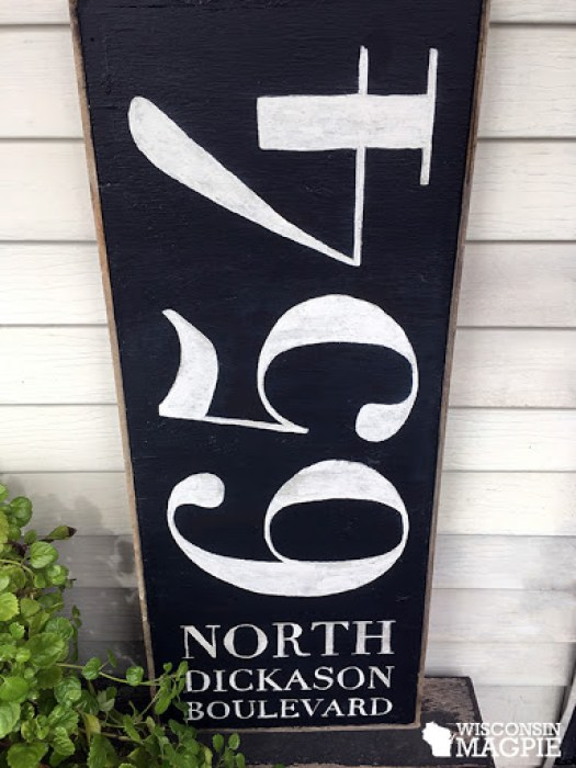two-sided chalk-painted sign