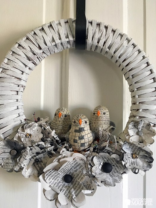chalk painted wreath with newspaper chicks and flowers