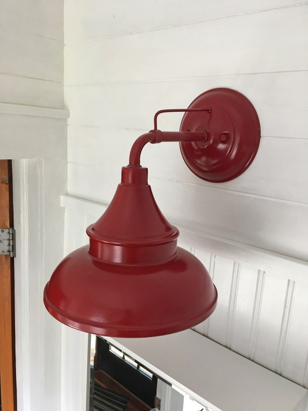 red barn light installed in bathroom
