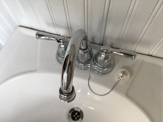 sink with old-fashioned rubber stopper on a chain