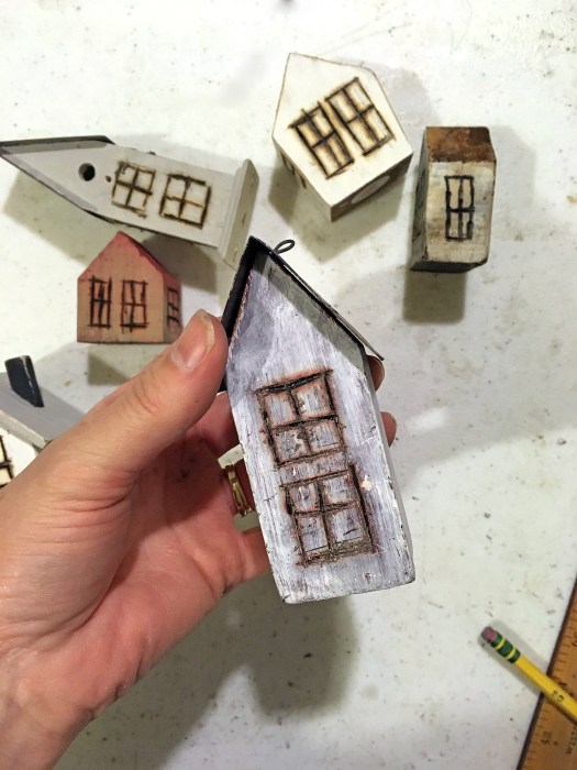 tiny houses being transformed from birdhouses into a mini village