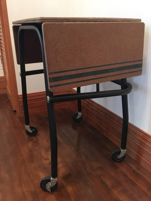black typewriter cart with grain sack stripes on the ends of the table