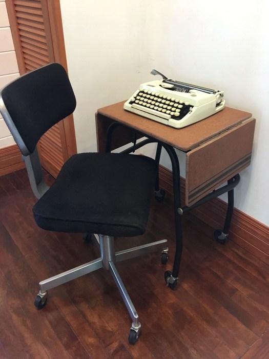 vintage typewriter cart with typewriter on it