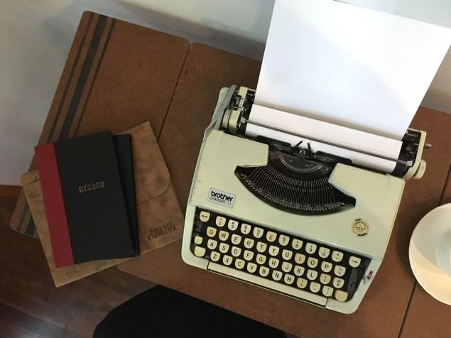vintage brother typewriter on typewriter cart