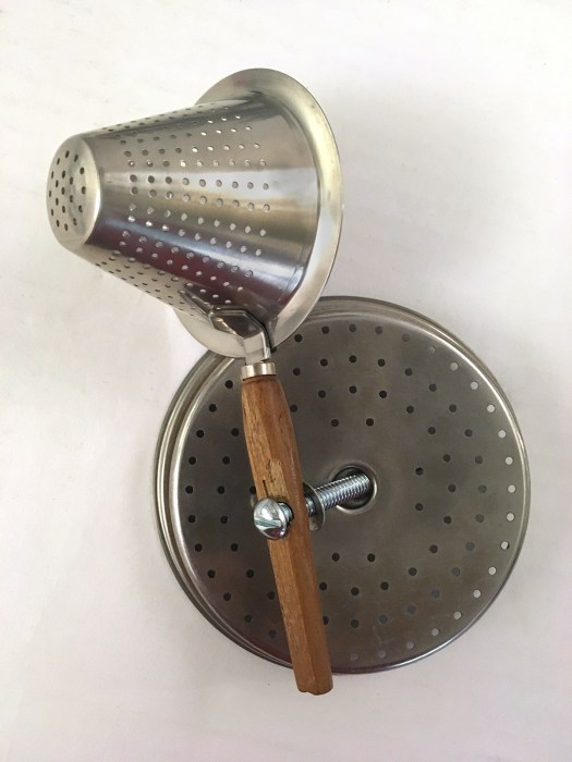 tea strainer basket attached to coffee basket top