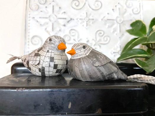 two birds decoupaged in newspaper