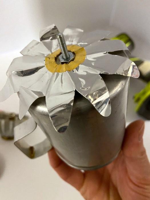aluminum christmas light reflector on top of salt shaker