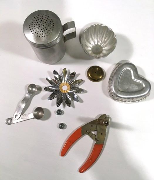 pieces of junk rabbit, including aluminum salt shaker, mini Jell-O mold, heart more, teaspoons, aluminum Christmas light reflector, etc.