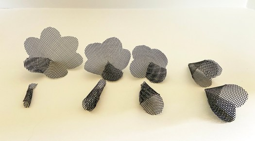 eight black mesh cones of varying sizes