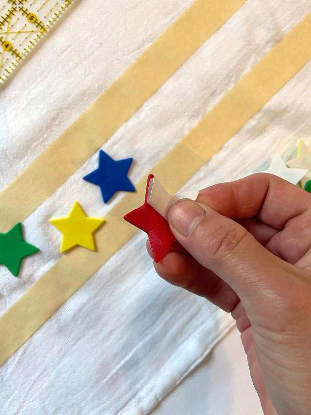 peeling adhesive back off of stars