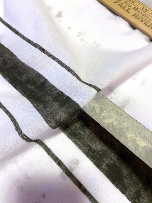 removing tape from grainsack stripes on dishtowel