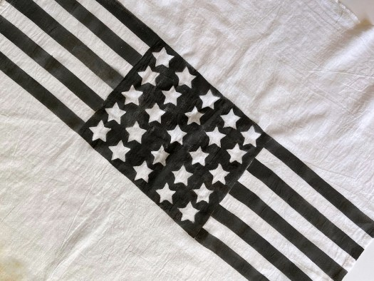 black and white flag dishtowel with a field of stars in the middle
