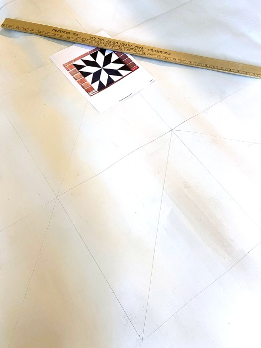 Vinyl flooring with horizontal, vertical and diagonal lines marked on it in pencil