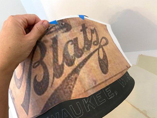 Placing a vintage Blatz logo onto a drum-shaped lampshade