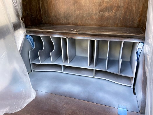 Painting the pigeon holes in a secretary desk with white spray paint