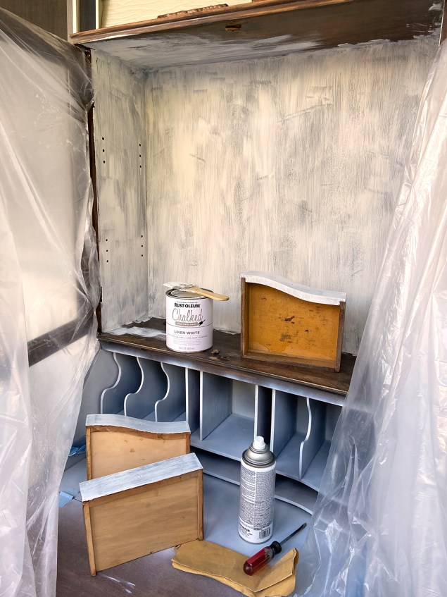 Painting the interior of cabinet and desk in Rust-Oleum Chalked paint in Linen White