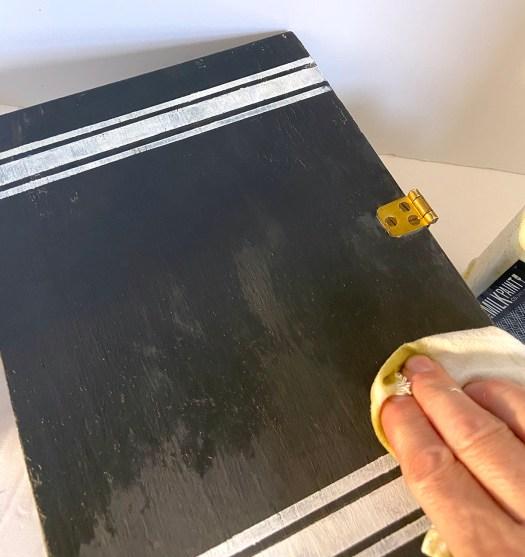 applying hemp oil to vintage thread box