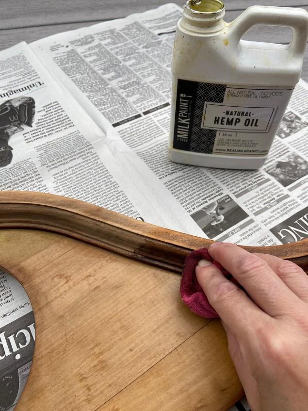 wiping hemp oil onto wood