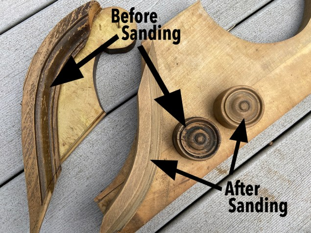 furniture pediment showing portions of the trim before sanding and after sanding