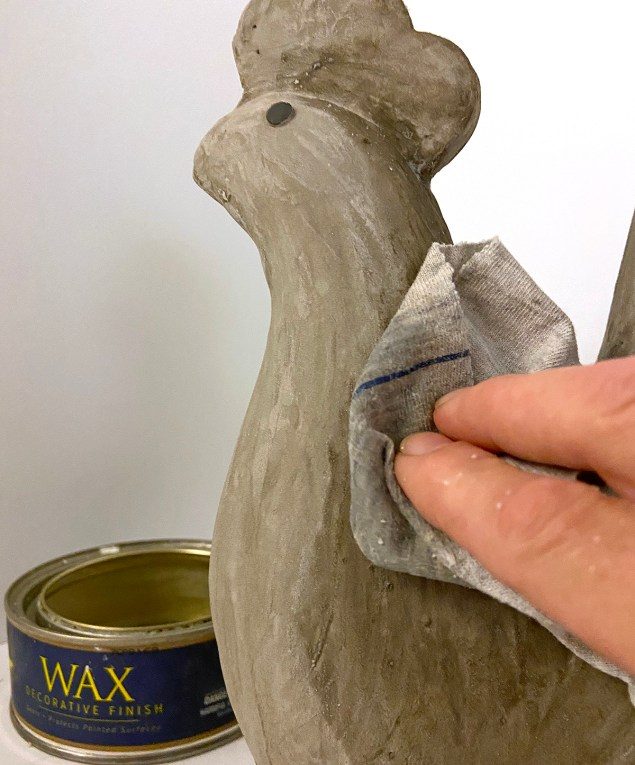 Waxing DIY concrete garden sculpture