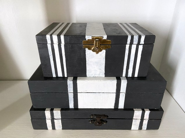Stack of three painted black and white boxes