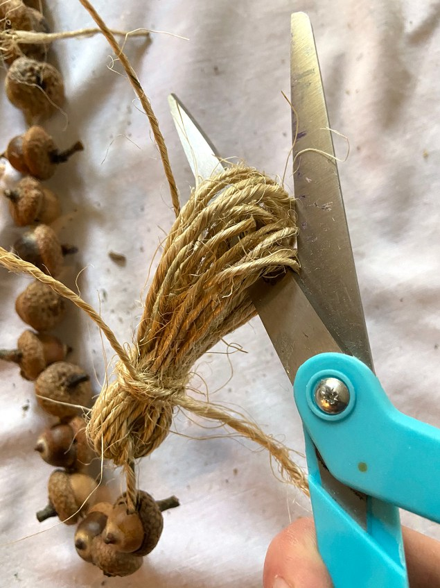 cutting the looped end of the tassel with a scissors